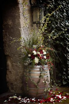 Barrel of flowers. Neat idea for floral decor