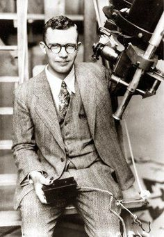 The man who discovered Pluto is currently on his way there! Or at least his ashes are... Clyde Tombaugh discovered Pluto in February, 1930. He died at the age of 90 in 1997 and his ashes were placed inside a capsule inscribed with the writing that would normally go on one's gravestone. That capsule is currently on board the New Horizons space probe, which should pass Pluto in 2015.