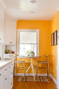 Yellow is associated with . makes any space brighter, more creative and . some genius ways to decorate with yellow walls living room kitchen bedroom Decor, Yellow Walls, Living Room Kitchen, Interior, Home, Orange Walls, Home Deco, Yellow Walls Living Room, Colonial Style Homes
