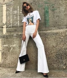 1f47d5bbf9 Love those white flared pants with cute tee and chic black handbag. White  Flare Pants