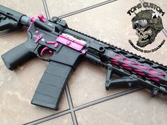This Beautiful AR is finished in Cerakote Sig Pink and Graphite Black. The flutes on the barrel were special coated in Sig Pink to make it POP...