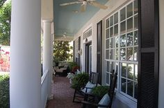 I love this porch's blue painted ceiling.
