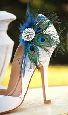 love this for bridesmaids with a silver shoe, and then for my dark navy shoes, but maybe albino peacock feathers if not regular feathers. :)