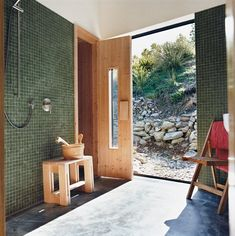 On the shores of New Zealand's Lake Wakatipu, architects Bronwen Kerr and Pete Ritchie designed a home for themselves and their children. Queenstown gets cold in winter, hence the installation of a sauna. Photo by: Stephen Oxenbury Modern Saunas, Jungle House, Open Showers, Bath Design, Concrete Floors, Decoration, Indoor Outdoor, Beautiful Homes, Architecture Design