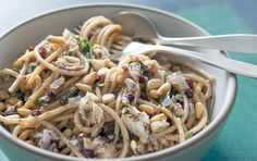 The richness of sardines and toasted pine nuts are the perfect partners for a tangle of hearty whole wheat spaghetti and the bright, vivid flavors of currants plumped in orange juice and plenty of chopped parsley. Add a pinch or two of crushed red chile flakes, if you like.