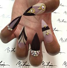 Stiletto nails with black and nude bling design