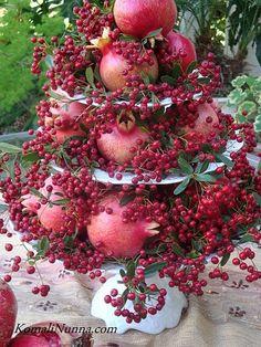 Etagere - gorgeous arrangement using pepper berries & pomegranates