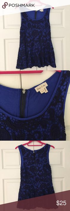 "Anthropologie Crochet Lace Peplum Top navy crochet lace overlayed in a royal blue knit peplum top. features exposed zipper. 100% cotton with 100% rayon knit lining. excellent pre-owned condition with just very light pilling under arms and a very small .5"" section on right side seam near waist where crochet has come unstitched from seam (see close-up pic). size small. bust flat is 15.5"", waist flat waist s 14.25"", length is 24.5"". feel it runs small - check measurements please. Anthropologie…"