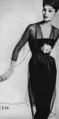 September Vogue 1959  Wearing a black sheath dress with a shadow of grey organdie draped over the top, by Jacques Heim, photographed by Irving Penn.