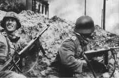 German soliders with MP40 sub machine guns.  My favorite WWII weapon.