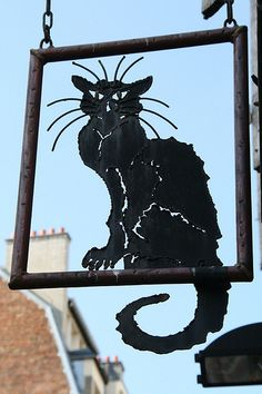"Iconic black cat (""chat noir"") sign - photo taken by sylviedjinn, via Flickr."