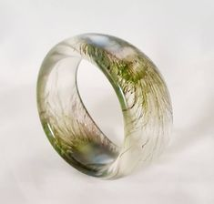 Excited to share this item from my #etsy shop: Vintage Peacock feather bangle, chunky bangle, lucite bangle, Animal bangle, green peacock feather bangle.