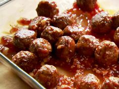 Comfort Meatballs from FoodNetwork.com  These are luscious! I made it my own by using a 1/8 cup measure to make them. I baked them in the oven at 400 f for 10 mins instead of frying them and I doubled the sauce because was never enough. We have them with rice.oh yes and I use ketchup without HF corn syrup, I am not a fan.