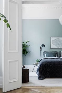 Cozy ain airy bedroom painted in a light green shade