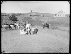 Pioneer family in Custer County, Nebraska. 1887 - Nice house and barn in the background
