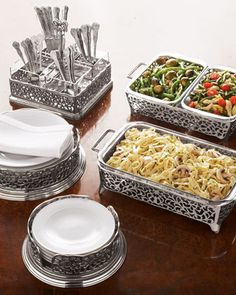"Exclusively ours. These pierced serving pieces dress up even the most basic meal.        Holders are made of pierced nickel-plated aluminum.      Bakers have dishwasher- and oven-safe glass liners.      Glass liners in flatware caddy are dishwasher safe. Each section measures 4.25""Sq. x 4""T and comfortably holds 20–30 pieces of flatware.      Imported."