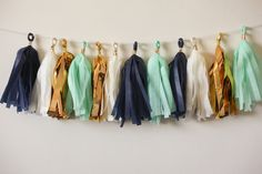 Lets celebrate with this navy, ivory, mustard gold mylar, mint colored garland!    This tassel garland is great for:  weddings bridal showers