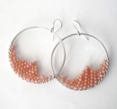 wire wrapped sterling silver hoop earrings pink peach coral beads. $40.00, via Etsy.