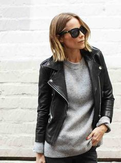 Gray sweater with leather jacket.