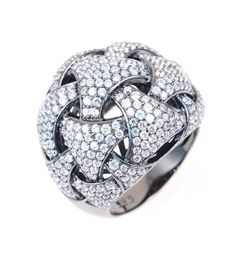 Gorgeous micro pave' lab created simulated diamond dome cocktail ring. Set in rhodium plated Sterling silver. Dia: 1.38ctw Color: E Clarity: VVS1 Metal: rhodium plated 925 silver Size: please message