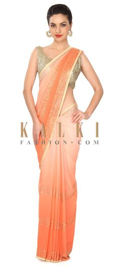 Buy this Peach shaded saree adorn in kundan embroidered border only on Kalki