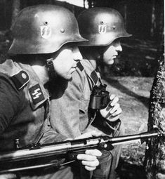 Soldiers of the Waffen SS (one with a MP40)