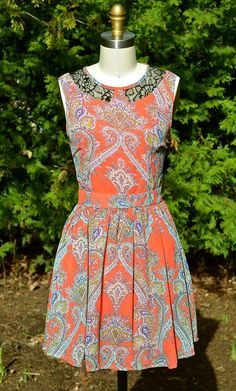 Yes please paisley - this dress comes with a perfect fit and pretty black lace cuts outs at the neck