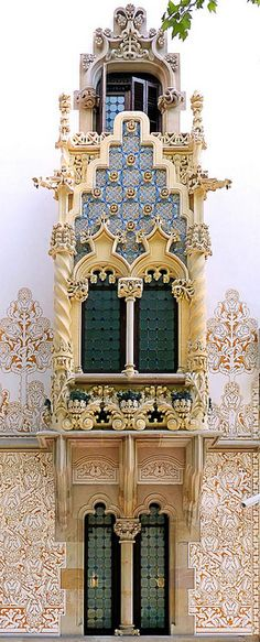 Casa Macaya, Barcelona, Spain. Declared a Cultural Asset of National Interest, the Macaya house was finished in 1901. The architect, Josep Puig i Cadafalch, revived the grandiose of the Gothic style with his design of the facade. Arches & columns are intricately carved & decorated by ironwork next to white stucco walls with elaborately engraved designs.