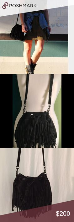 MINKOFF BLACK FRINGE BAG Made of leather with fringe detail. *Magnetic snap with drawstring closure. * Flat base to provide upright structure. * Lined interior. * Interior back-wall zip pocket. * Two interior multifunctional slip pockets. * Imported. *Measurements: * Bottom Width: 10 in * Depth: 4 in * Height: 8 in * Strap Length: 43 in * Strap Drop: 21 in drawstring bucket bag, the Mini Fiona boasts a graceful boho-chic look with its curtains of swingy fringe. Bold metallic grommets. ALMOST…