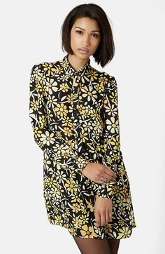 Free shipping and returns on Topshop Daisy Print Shirtdress at Nordstrom.com. A golden daisy print brightens up a long-sleeve shirtdress styled for a sophisticated look with a spread collar, front-button placket and fitted cuffs.