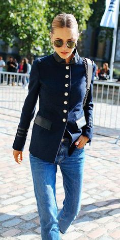Pernille Teisbaek in a button-down jacket, blue jeans and Ray Ban sunglasses