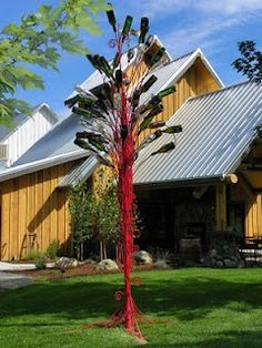 Winery has a bottle tree showcasing their own wine bottles