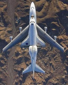 Bird's-eye view of Space Shuttle Endeavour as it flies over the Mojave Desert on the back of a modified Boeing 747