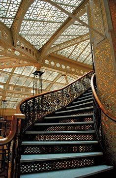 Staircase inside the Rookery BUilding in Chicago, Illinois. Frank Lloyd Wright is the architect of the lobby renovation in 1905.