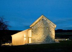 300-year old Hillcott Barn renovation in Hereford, UK by RRA Architects. Click through to see how the architects incorporated modern glass and steel elements into the stone structure.