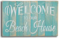 """Teal-blue washed hand-painted beach wall sign with off-white lettering, """"""""Welcome to our Beach House"""""""". A fun piece of small cottage wall art to great your guests when they arrive at your coastal ho"""