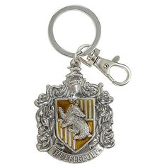Harry Potter Hufflepuff Crest Metal Key Chain Hot Topic ($8.90) ❤ liked on Polyvore featuring accessories, long key chains, fob key chain, ring key chain, key chain rings and metal key chain