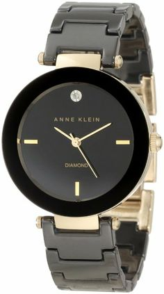 This Anne Klein watch, with its bold black ceramic and genuine diamond beauty mark, is replete with feminine sophistication. Japanese Quartz...