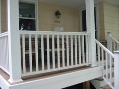 Brown/tan Wood Composite Deck Porch Floor With White Side Boards And Stair  Risers.