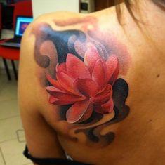Colored Lotus Tattoo On Left Back Shoulder For Girls