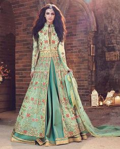 1. Sea green embroidered front slit net and silk suit  2. Attire is beautifully adorned with embroidered work 3. Comes with a matching bottom and dupatta 4. Can be stitched upto size 42 inches