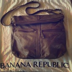"""Banana Republic Adjustable Strap Lamb Leather Bag Pristine Banana Republic large sized taupe colored soft pebbled 100% lamb leather satchel. Zipped folder over flap; 2 exterior zipped pockets & 3 interior pockets: 1 large zipped/2 slotted. Measures approximately 16"""" W x 16"""" H x 4"""" D / Dustbag & care card included. Banana Republic Bags Satchels"""