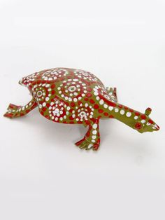 """Tiny Tin Tortoise. Tortoise is a symbol of wisdom, creation, steadfastness and tranquility. It is also a powerful totem for protection, as withdrawing into its shell is an amazing self-defense mechanism. Due to its long lifespan, it represents longevity and stability. In African fairy tales, the tortoise is the most clever animal.    Height: 1""""   Length: 2.5""""   Width: 2""""   Artist: sculpted by Joseph Thomas, painted by Yeukai Tanyara  Made In: Zimbabwe. $7.00"""