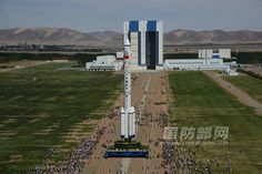 Spaceflight Now | Shenzhou Mission Report | PHOTOS: Long March 2F rocket moved to launch pad