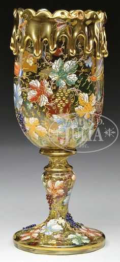 MOSER DECORATED CHALICE. Moser amber glass chalice is decorated with an allover…