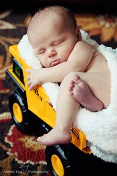 Baby boy in a Tonka truck. Perfect, we have Ben's old Tonka trucks, one day :]