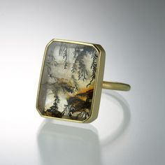 An 18k yellow gold ring with a rectangular dendritic quartz. Stone measures approximately 17mm x 13mm . Size 5.25.