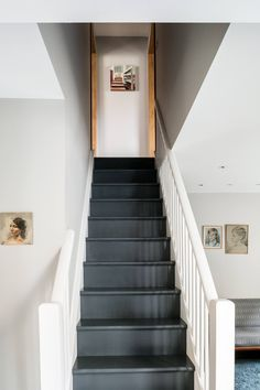 gray flooring The walls throughout are painted French Grey from Little Greene, and the stairs are a dark gray standard floor paint. Black Painted Stairs, Black Stairs, Painted Floors, Dark Staircase, Spiral Staircases, Tile Stairs, House Stairs, Paint Stairs, Grey Hallway