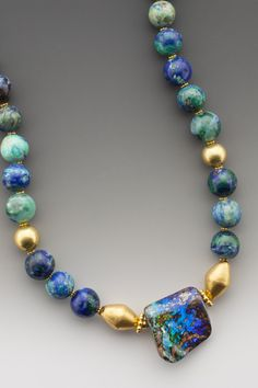 """Elle Schroeder Sweet Oasis An Australian boulder opal with restful reservoirs of cool blue stretching into infinity. On round, charmingly unsophisticated beads of azurite interspersed with 18K gold beads. Pendant drop 1""""."""