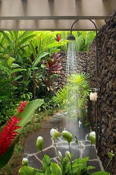 Lush outdoor shower space with Hawaiian feel